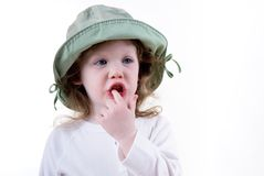 Little girl with finger in her Stock Photos