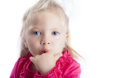 Little Girl with Finger in Mouth royalty free stock images