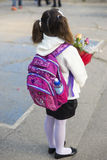 Little girl in the first day of school Stock Photos