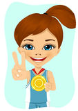 Little girl with a first place medal. Little cute  girl with a first place medal showing victory sign hand gesture Stock Photography