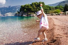 Little girl first time on the beach Royalty Free Stock Photos