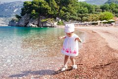 Little girl first time on the beach Stock Image