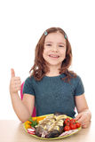 Little girl with fish and thumb up Stock Photo