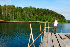 Little girl fishing. Royalty Free Stock Photography