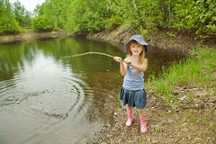 Little girl are fishing Stock Photos