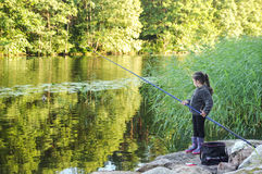 Little girl fishing Stock Image