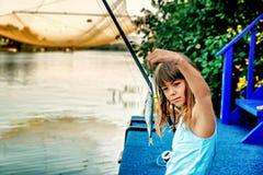 Little girl fishing on the river Bojana in Montenegro Stock Images