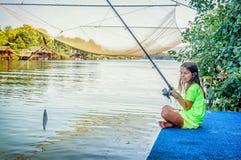 Little girl fishing on the river Bojana in Montenegro Royalty Free Stock Image