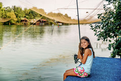 Little girl fishing on the river Bojana in Montenegro Royalty Free Stock Photos