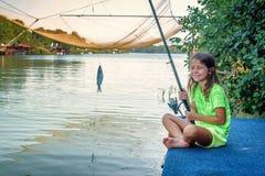 Little girl fishing on the river Bojana in Montenegro Stock Photography