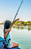 Little girl fishing on the river Bojana in Montenegro Royalty Free Stock Images