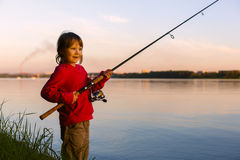 Little girl fishing with spinning Stock Photography