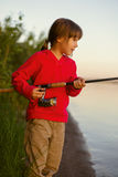 Little girl fishing with spinning Stock Photos