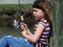 Little girl fishing Sun & Wind Royalty Free Stock Images
