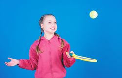 Little girl. Fitness diet bring health and energy. sport school workout of teen girl. Sport game success. Tennis player. With racket and ball. Childhood stock photos
