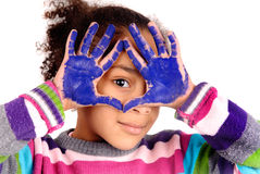 Little girl. Five year old girl with hands painted stock photography