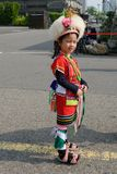 Cute little Taiwanese girl in garb of Hualien Tribe with headdress and skirt, Kaohsiung, Taiwan. Little girl - five years old - from dancing group in colorful stock images