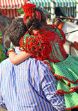 Little girl with flamenco dress on the shoulders of his father, Seville Fair, Andalusia, Spain Stock Photo