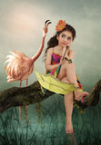 Little girl and flamingos Royalty Free Stock Photo