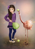Little girl and flamingos stock photography