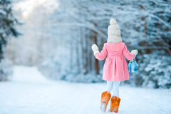 Little girl with flashlight in frozen forest on Christmas eve Royalty Free Stock Image