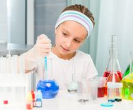 Little girl with flasks for chemistry Stock Photography