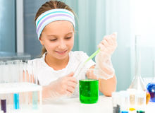 Little girl with flasks for chemistry Royalty Free Stock Images