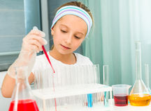Little girl with flasks for chemistry Royalty Free Stock Photos