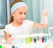 Little girl with flasks for chemistry Royalty Free Stock Image