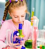 Little girl with flasks for chemistry Royalty Free Stock Photography