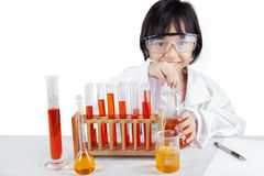Little girl with flasks for chemistry Stock Photo