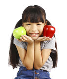 A little girl flexes her muscle while showing off the apple that made her strong and healthy Stock Photos