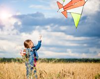 Little girl flies a kite Royalty Free Stock Images