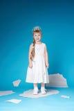 Little girl floating on ice floe Stock Photo