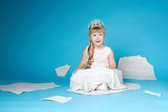 Little girl floating on ice floe Royalty Free Stock Image