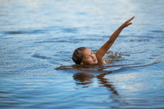 Little girl floating on the river. Royalty Free Stock Image