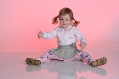 Little girl on the floor Royalty Free Stock Image