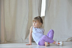 Little girl on the floor Royalty Free Stock Photos