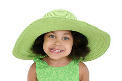 Little girl in floppy hat. Little African-American girl in green wearing a large floppy green summer hat, isolated on a white background stock photo