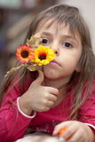 Little girl with flower. Little sad girl holding lavender flowers, lost in thought Royalty Free Stock Photos