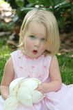 Little girl with flower. With expressive face royalty free stock photography