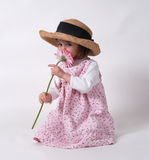 Little Girl with Flower. 3-year-old holding flower Royalty Free Stock Image