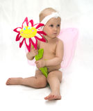 The little girl with a flower. The Image of the child on a white background Stock Photo