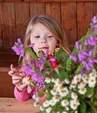 Little Girl Flower Arranging Royalty Free Stock Photos