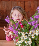 Little Girl Flower Arranging Royalty Free Stock Photos