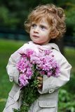 Little girl with a flower bouquet Royalty Free Stock Image