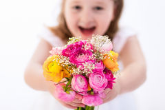 Little girl with flower bouquet Stock Image