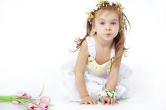 Little girl in flower dress Stock Photos