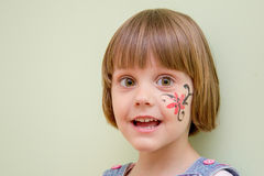 Little girl with flower face paint Stock Images