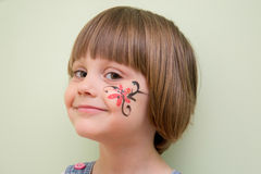 Little girl with flower face paint Stock Photo
